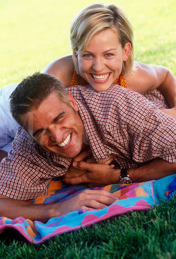 Smiling young couple relaxing.