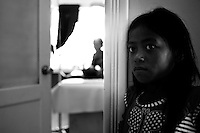 A young girl waits for her relatives treatment outside in the ward of the hospital.