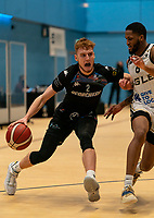 Cameron Hildreth of Surrey Scorchers driving forward under pressure from Cortez Edwards of Newcastle Eagles during the BBL Championship match between Surrey Scorchers and Newcastle Eagles at Surrey Sports Park, Guildford, England on 20 March 2021. Photo by Liam McAvoy.