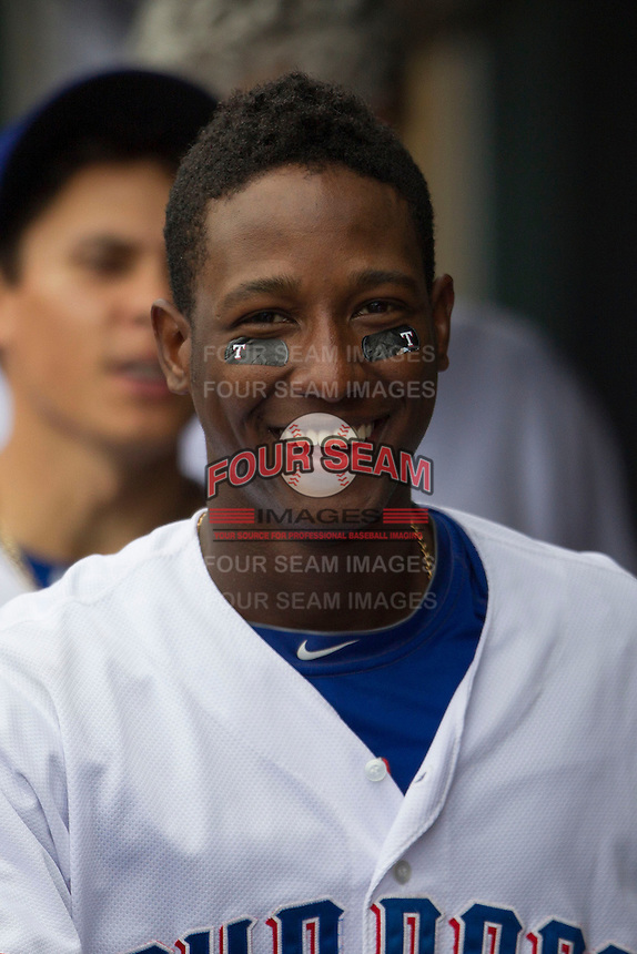 Round Rock Express shortstop Jurickson Profar #10 smiles in the dugout during the Pacific Coast League baseball game against the  New Orleans Zephyrs on April 21, 2013 at the Dell Diamond in Round Rock, Texas. Round Rock defeated New Orleans 7-1. (Andrew Woolley/Four Seam Images).