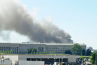 Sept 11, 2001, Washington, DC, United States<br /> <br /> Smoke and flames rose over the Pentagon at about 10 a.m. on Sept 11, 2002  following the crash of a American Airlines flight 77, from Dulles Airport , The Boeing 757  crashed into the side of the building after beeing hijack by terrorists.<br /> <br /> Part of the building hit collapsed; The building was evacuated, as were other federal buildings in the Capitol, including the White House. The number of casualties is unknown. The Pentagon's workday population is about 24,000. Updates will follow as they come available. Photos by Gerry J. Gilmore. (Released) <br /> <br /> <br /> (Mandatory Credit: U.S. Air Force photo