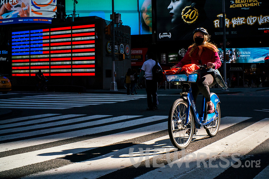 NEW YORK, NY - OCTOBER 15: A woman rides a bike at Times Square on October 15, 2020 in New York, At least 4,477 bicycles have been reported stolen with an increase of 27 percent from same period last year, according to the police. (Photo by Eduardo MunozAlvarez/VIEWpress)