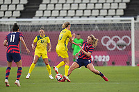 KASHIMA, JAPAN - AUGUST 5: Emily van Egmond #10 of Australia battles for the ball with Lindsey Horan #9 of the United States during a game between Australia and USWNT at Kashima Soccer Stadium on August 5, 2021 in Kashima, Japan.