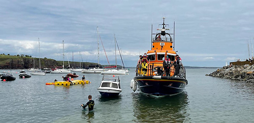 Dunmore East lifeboat with the four-metre angling vessel found drifting near rocks is brought safely back at the slipway in Dunmore East