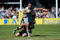 Samu Manoa of Northampton Saints is tackled during the Aviva Premiership match between Harlequins and Northampton Saints at the Twickenham Stoop on Saturday 4th May 2013 (Photo by Rob Munro)