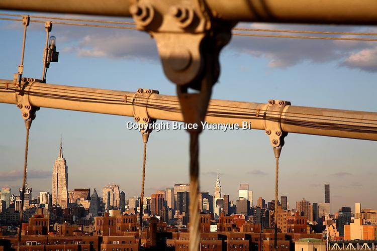 The skyline of New York City from Brooklyn Bridge. New York City. USA