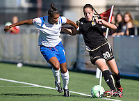 19 July 2009:  Erika of the FC Gold Pride dribbles the ball away from Abby Crumpton of the Boston Breakers during the game at Buck Shaw Stadium in Santa Clara, California.   Boston Breakers defeated FC Gold Pride, 1-0.