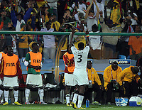 Asamoah Gyan (R) of Ghana celebrating scoring the winning goal with a wave to the Ghana fans