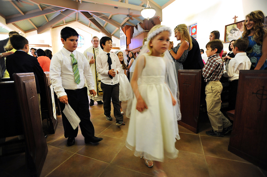 The 2012 Children's Faith Formation class celebrated their First Communion at Holy Spirit Catholic Church with Father Daniel Looney, Saturday, May 19, 2012 in Sacramento, California's Land Park neighborhood. (photo by Pico van Houtryve)