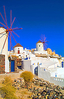 Houses and windmills on the mountain cliffs of the small isolated roamntic city of Oia, Santorini Greece