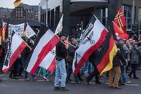 """Etwa 2.000 rechtsradikale Menschen demonstrierten am Samstag den 12. Maerz 2016 in Berlin unter dem Motto """"Merkel muss weg!"""" gegen Angela Merkel, gegen Fluechtlinge und fuer """"Das deutsche Vaterland"""".<br /> Bis auf wenige Ausnahmen waren angereisten Teilnehmer Neonazis und Hooligans, NPD-, Pediga- und AfD-Mitglieder.<br /> Aufgerufen zu dem Aufmarsch hatten die Hooligan-Gruppen """"Buendnis fuer Deutschland"""" und """"Buendnis fuer Berlin"""".<br /> Im Bild: Demonstrationsteilnehmer mit einer Fahnen in den Farben des Deutschen Reichs und einem Reichsadler, bei dem das Hakenkreuz im Kranz durch ein Eisernes Kreuz ersetzt wurde. <br /> 12.3.2016, Berlin<br /> Copyright: Christian-Ditsch.de<br /> [Inhaltsveraendernde Manipulation des Fotos nur nach ausdruecklicher Genehmigung des Fotografen. Vereinbarungen ueber Abtretung von Persoenlichkeitsrechten/Model Release der abgebildeten Person/Personen liegen nicht vor. NO MODEL RELEASE! Nur fuer Redaktionelle Zwecke. Don't publish without copyright Christian-Ditsch.de, Veroeffentlichung nur mit Fotografennennung, sowie gegen Honorar, MwSt. und Beleg. Konto: I N G - D i B a, IBAN DE58500105175400192269, BIC INGDDEFFXXX, Kontakt: post@christian-ditsch.de<br /> Bei der Bearbeitung der Dateiinformationen darf die Urheberkennzeichnung in den EXIF- und  IPTC-Daten nicht entfernt werden, diese sind in digitalen Medien nach §95c UrhG rechtlich geschuetzt. Der Urhebervermerk wird gemaess §13 UrhG verlangt.]"""