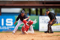 Detroit Tigers shortstop Mike Aviles (14) tags Mitch Reeves (34) sliding back into second base during an exhibition game against the Florida Southern Moccasins on February 29, 2016 at Joker Marchant Stadium in Lakeland, Florida.  Detroit defeated Florida Southern 7-2.  (Mike Janes/Four Seam Images)