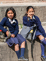 Nepal, Kathmandu.  Two Nepalese Schoolgirls in Uniform.  The one on the right is wearing a nose pin.