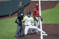Isaiah Thomas (8) of the Vanderbilt Commodores keeps his foot on third base after hitting a triple against the South Carolina Gamecocks at Hawkins Field on March 20, 2021 in Nashville, Tennessee. (Brian Westerholt/Four Seam Images)