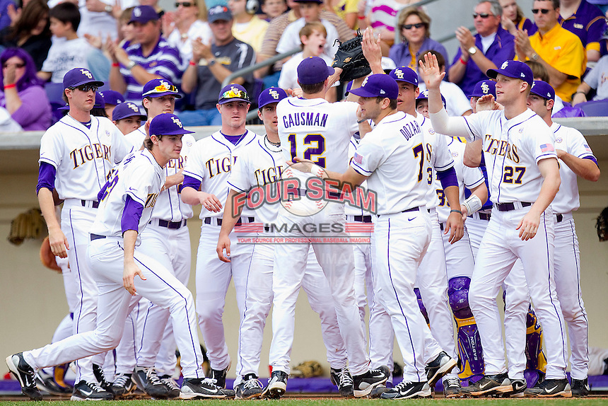 Kevin Gausman #12 of the LSU Tigers is congratulated by his teammates after escaping a bases loaded, no out jam in the top of the first inning against the Wake Forest Demon Deacons at Alex Box Stadium on February 19, 2011 in Baton Rouge, Louisiana.  The Tigers defeated the Demon Deacons 4-3.  Photo by Brian Westerholt / Four Seam Images