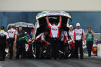 Sept. 18, 2011; Concord, NC, USA: NHRA crew members for funny car driver Mike Neff during the O'Reilly Auto Parts Nationals at zMax Dragway. Mandatory Credit: Mark J. Rebilas-