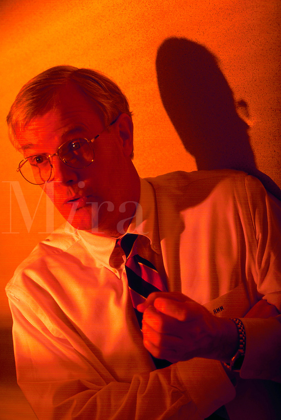 Businessman talking, red lighting