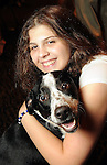 """Grace Raoisheaux with Cici at the """"Dog Days of Summer"""" Yappy Hour benefitting Citizens for Animal Protection and Golden Beginnings Golden Retriever Rescue at Hotel Derek Wednesday July 21,2010.(Dave Rossman/For the Chronicle)"""