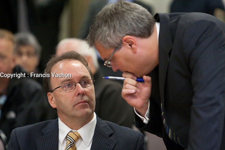 Former justice minister Marc Bellemare and his lawyer Jean-Francois Bertrand chat at the Inquiry Commission into the appointment process for judges, more well know as the Commission Bastarche, September 16, 2010 in Quebec City.<br /> <br /> PHOTO :  Francis Vachon - Agence Quebec Presse