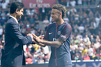 """Paris Saint-Germain's Brazilian forward Neymar waves to the crowd during his presentation to the fans at the Parc des Princes stadium in Paris on August 5, 2017. Brazilian superstar Neymar received a hero's welcome from Paris Saint-Germain fans at their Parc des Princes home on Saturday as he vowed to win """"lots of trophies"""" following his world record transfer. The 25-year-old was presented to fans on the pitch ahead of their opening Ligue 1 match of the season at home to Amiens, telling fans: """"Thank you! I'm very happy, I'm delighted to be here for this new challenge."""" # PRESENTATION DU JOUEUR NEYMAR AU PARC DES PRINCES"""