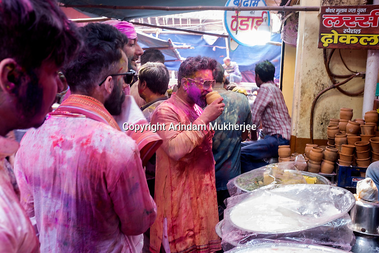 Young Indian Pilgrims dinking Vang at a shop in Vrindavan during the occassion of Holi Festival. Holi - The  Hindu festival of colour is celibrated for a week in the Brraj region of Uttar Pradesh, India.