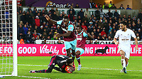 Michail Antonio of West Ham United clatters into Lukasz Fabianski of Swansea City as he makes a save during the Barclays Premier League match between Swansea City and West Ham United played at The Liberty Stadium, Swansea on 20th December 2015