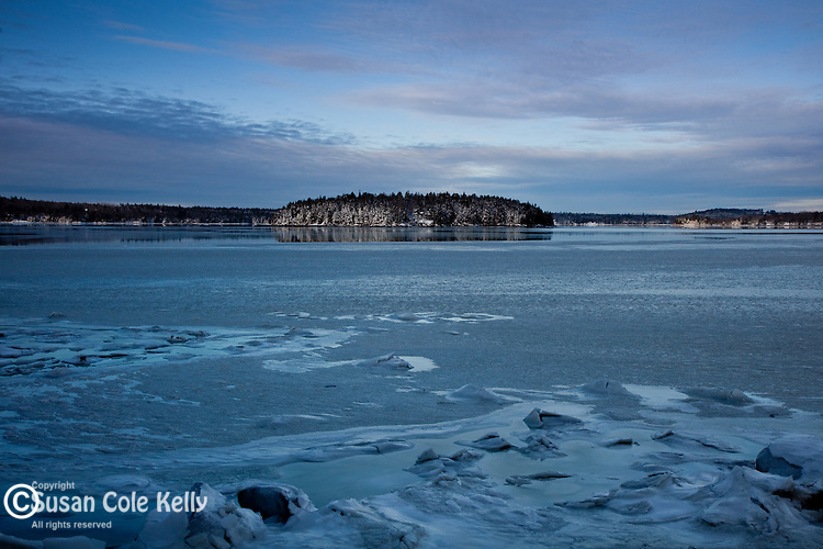 Early winter freezes the water into salt-ice on a bay in Hancock County, ME, USA