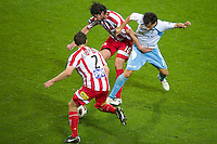 MELBOURNE, AUSTRALIA - NOVEMBER 27: Alex Brosque of Sydney FC tackles Wayne Srhoj of the Heart during the round 16 A-League match between the Melbourne Heart and Sydney FC at AAMI Park on November 27, 2010 in Melbourne, Australia. (Photo by Sydney Low / Asterisk Images)
