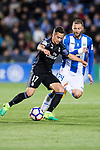 Lucas Vazquez (l) of Real Madrid battles for the ball with David Timor Copovi of Deportivo Leganes during their La Liga match between Deportivo Leganes and Real Madrid at the Estadio Municipal Butarque on 05 April 2017 in Madrid, Spain. Photo by Diego Gonzalez Souto / Power Sport Images
