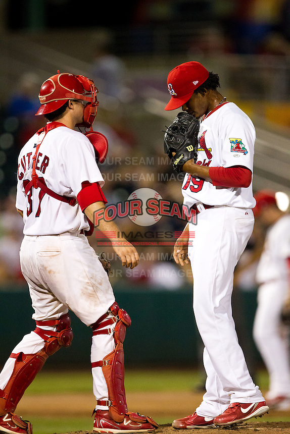 Francisco Samuel (19) of the Springfield Cardinals talks with Charlie Cutler during a game against the Northwest Arkansas Naturals at Hammons Field on August 1, 2011 in Springfield, Missouri. Springfield defeated Northwest Arkansas 7-1. (David Welker / Four Seam Images)
