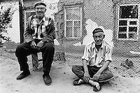 Kazakhstan. Aralsk. Two old men. A russian man seats on a wood bench, the other Kazakh sits on the ground. Aralsk is located in the Kyzyl Orda Province. © 2008 Didier Ruef