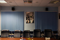 An image of Putin looks down on the editorial meeting room in the offices of Komsomolskaya Pravda in Moscow, Russia.