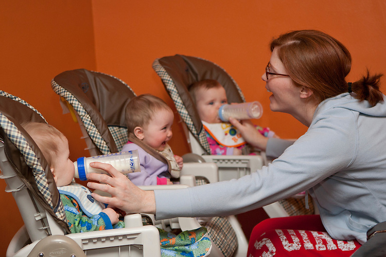 Sarah feeds Nathan, left, and Katelyn, right, while keeping Marianne entertained. Sarah claims keeping all three happy at once tends to be a challenge.