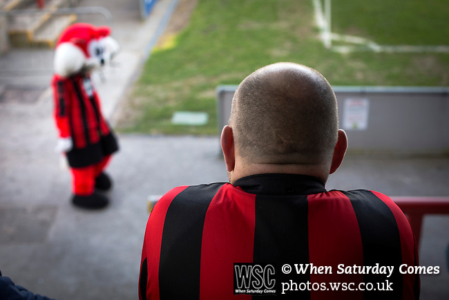 Morecambe 0 Plymouth Argyle 2, 25/03/2016. Globe Arena, League 2. A home fan watching the first-half action as Morecambe hosted Plymouth Argyle in a League 2 fixture at the Globe Arena. The stadium was opened in 2010 and replaced Morecambe's traditional home of Christie Park which had been their home since 1921, the year after their foundation. Plymouth won this fixture by 2-0 watched by 2,081 spectators, in a game delayed by 30 minutes due to traffic congestion affecting travelling Argyle fans.  Photo by Colin McPherson.