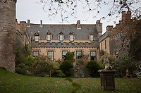 The enclosed garden in the south front, the original Jacobean dormers can be seen above the later castellated additions to the facade