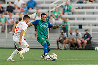 HARTFORD, CT - AUGUST 17: Christian Gomez #8 of Hartford Athletic passes the ball as Stavros Zarokostas #9 of Charleston Battery closes during a game between Charleston Battery and Hartford Athletic at Dillon Stadium on August 17, 2021 in Hartford, Connecticut.