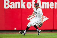 Derek Mattea (1) of the Missouri State Bears tries to field a ball hit to left field during a game against the Bradley Braves on May 13, 2011 at Hammons Field in Springfield, Missouri.  Photo By David Welker/Four Seam Images