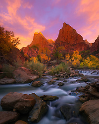 A spectacular display of light frames the Court of the Patriarchs, photographed from the shore of the Virgin River in Zion National Park.