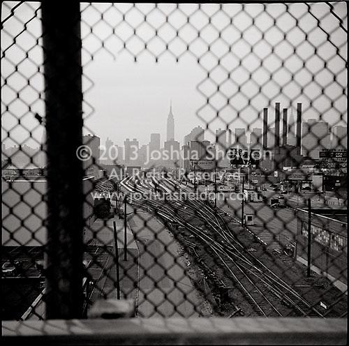 Manhattan seen through chain link fence<br />