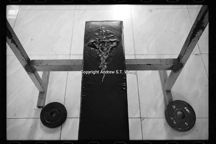 A workout equipment is seen at the gym of Dongguan Guangming Middle School in Dongguan, Guangdong province, November 2011.