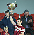 St Joseph's Doora Barefield  captain Kevin Dilleen lifts the cup following their Intermediate county final win over Broadford  in Cusack Park. Photograph by John Kelly.