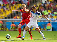 Kevin De Bruyne of Belgium and Sergey Ignashevich of Russia