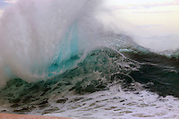 A big breaking wave with a fanning lip on the North Shore of O'ahu.