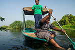 Fishing Cat (Prionailurus viverrinus) biologists, Maduranga Ranaweera and Anya Ratnayaka, on boat in urban wetland, Urban Fishing Cat Project, Diyasaru Park, Colombo, Sri Lanka