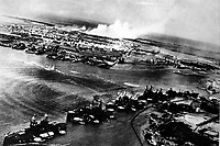 Captured Japanese photograph taken during the attack on Pearl Harbor, December 7, 1941.  In the distance, the smoke rises from Hickam Field.  (Navy)<br /> NARA FILE #:  080-G-30550<br /> WAR & CONFLICT BOOK #:  1133