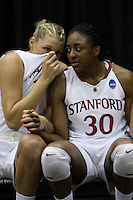 BERKELEY, CA - MARCH 30: Nneka Ogwumike and Jayne Appel chat on the bench during Stanford's 74-53 win against the Iowa State Cyclones on March 30, 2009 at Haas Pavilion in Berkeley, California.