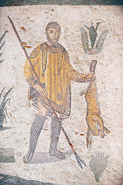 Hunter with a hare from the Room of The Small Hunt, no 25 - Roman mosaics at the Villa Romana del Casale which containis the richest, largest and most complex collection of Roman mosaics in the world, circa the first quarter of the 4th century AD. Sicily, Italy. A UNESCO World Heritage Site.