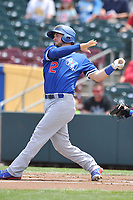 Oklahoma City Dodgers catcher Kyle Farmer (12) swings at a pitch against the Omaha Storm Chasers at Werner Park on June 24, 2018 in Omaha, Nebraska. Omaha won 8-0.  (Dennis Hubbard/Four Seam Images)