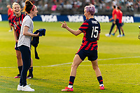EAST HARTFORD, CT - JULY 5: Rose Lavelle #16 and Megan Rapinoe #15 of the United States joke around after a game between Mexico and USWNT at Rentschler Field on July 5, 2021 in East Hartford, Connecticut.