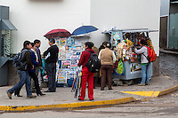 Peru, Cusco.  Sidewalk Vendors, Snacks, Umbrellas, Newspapers.  Avenida del Sol.